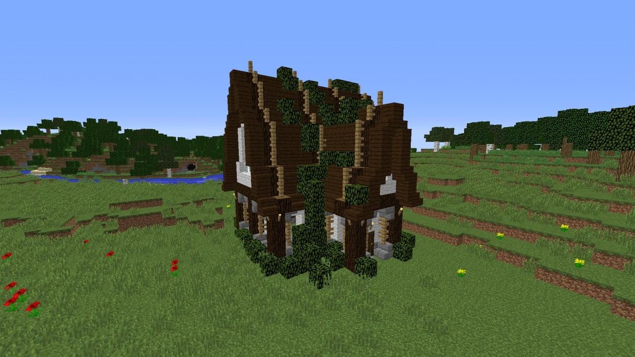 Haus mit laub auf dem dach